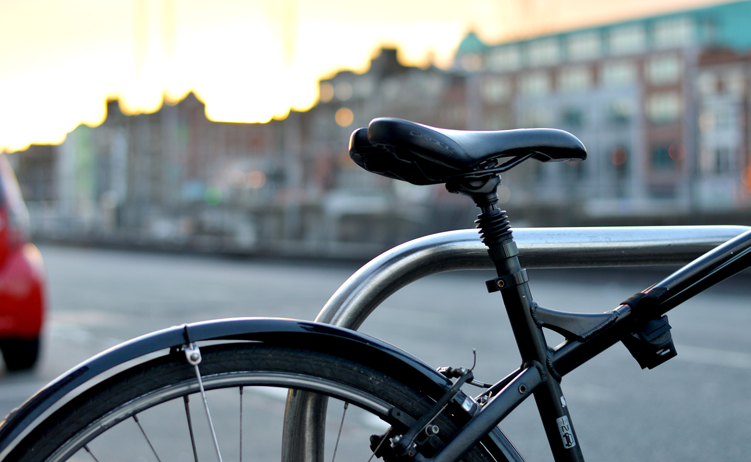 Black bicycle with city background