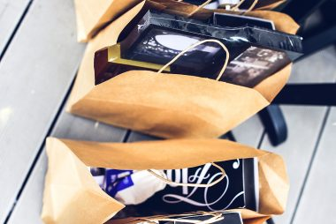 Brown shopping bags filled with black friday gifts