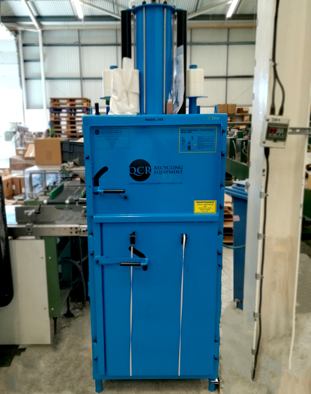Blue plastic baler in factory